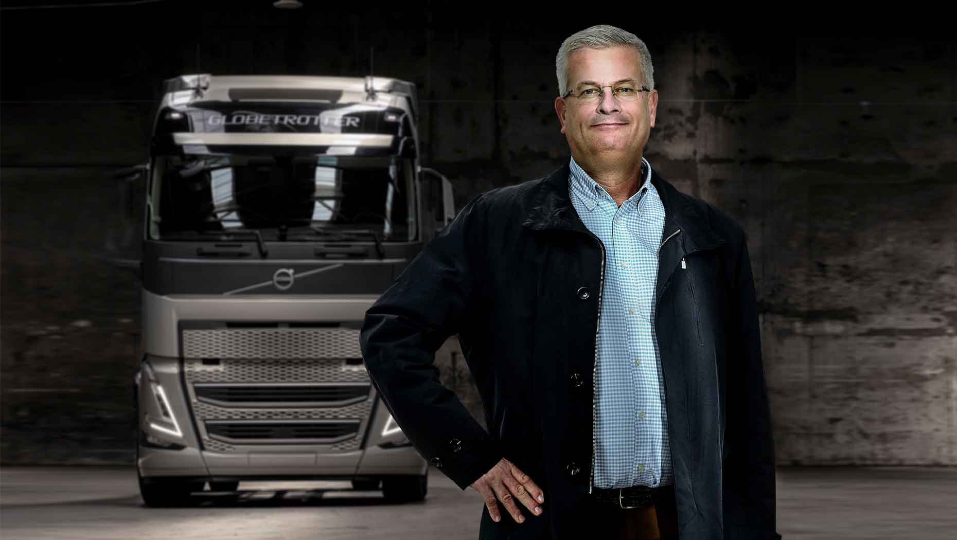 Tomas Thuresson, Commercialisation Manager, stands in front of the new Volvo FH with I-Save