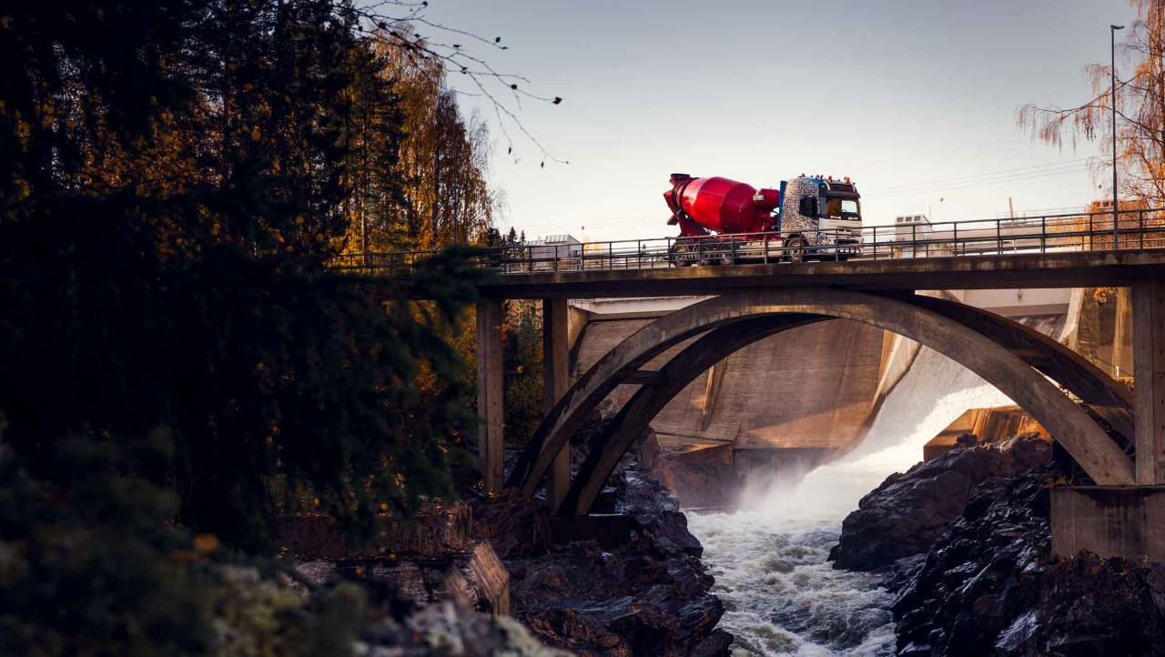 The Volvo FMX driving over a river on a bridge